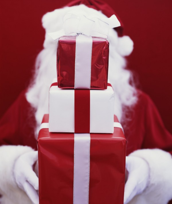 Santa Holding Stack of Gifts