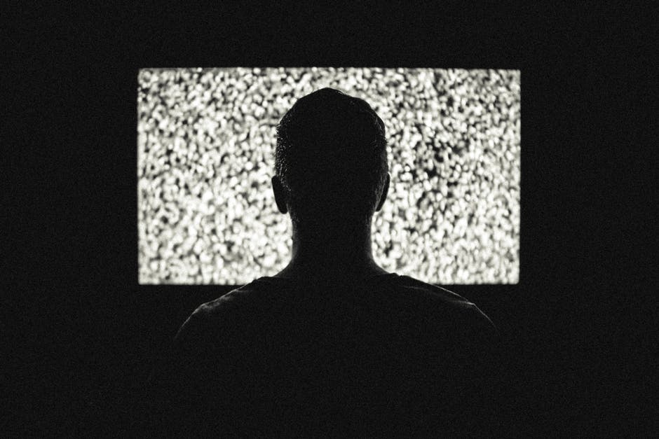man in front of a tv