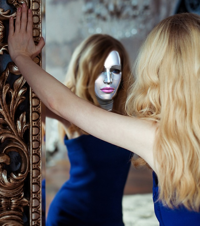 girl with silver face looking in the mirror