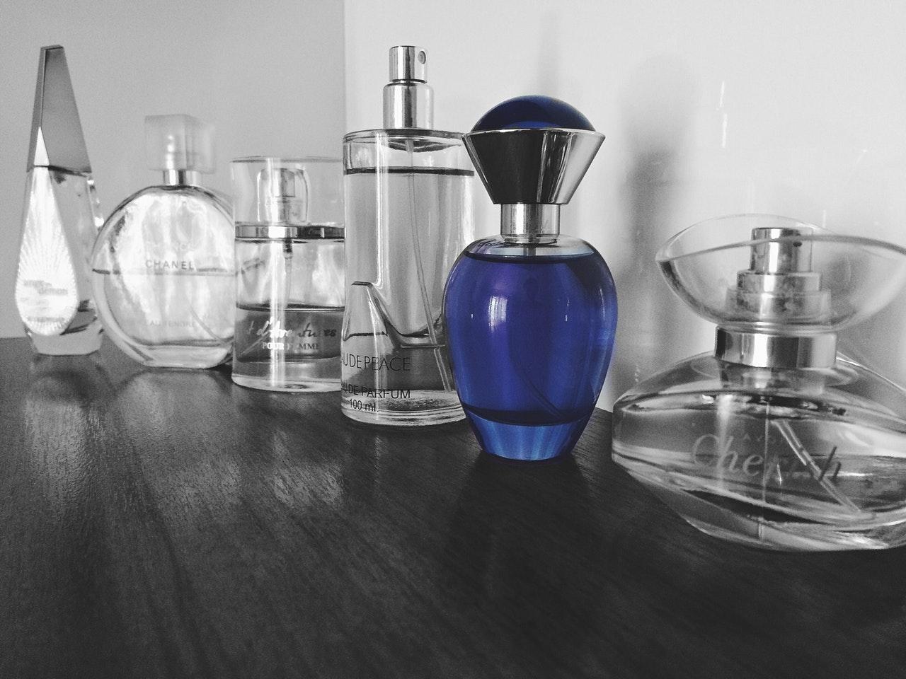 Fragrance bottles on wooden surface
