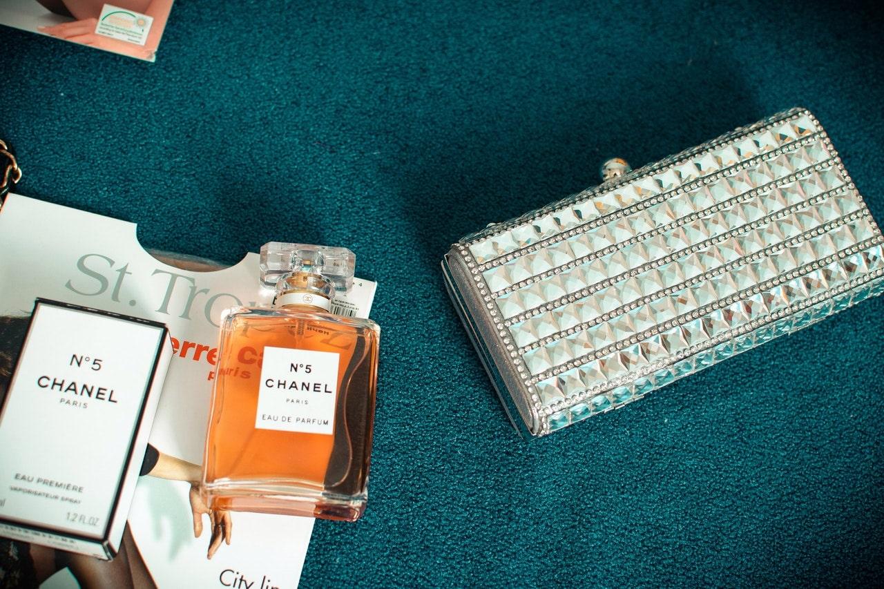 Perfume near purse