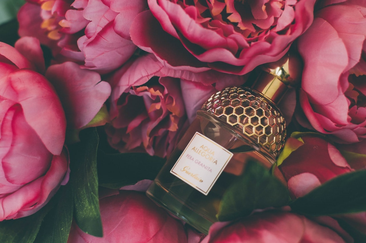 Perfume on pink roses