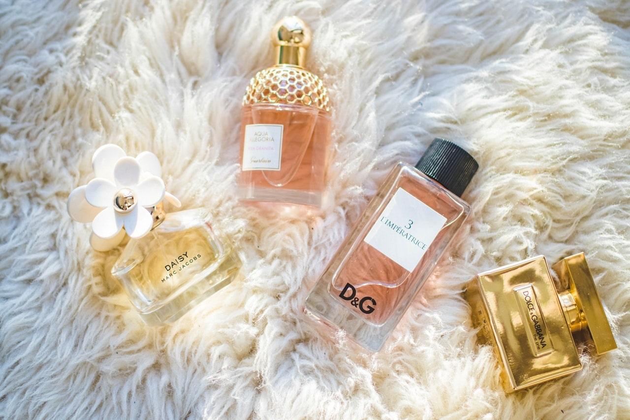 Perfumes on white fur
